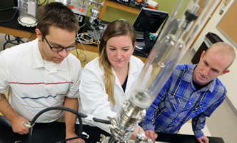 Faculty member working with students in a nanoscale science lab.