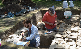 Students in the Community Archaeology Program working at a dig site.