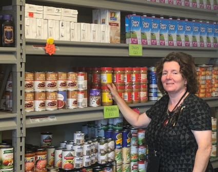 Robyn King in College's Food Pantry.