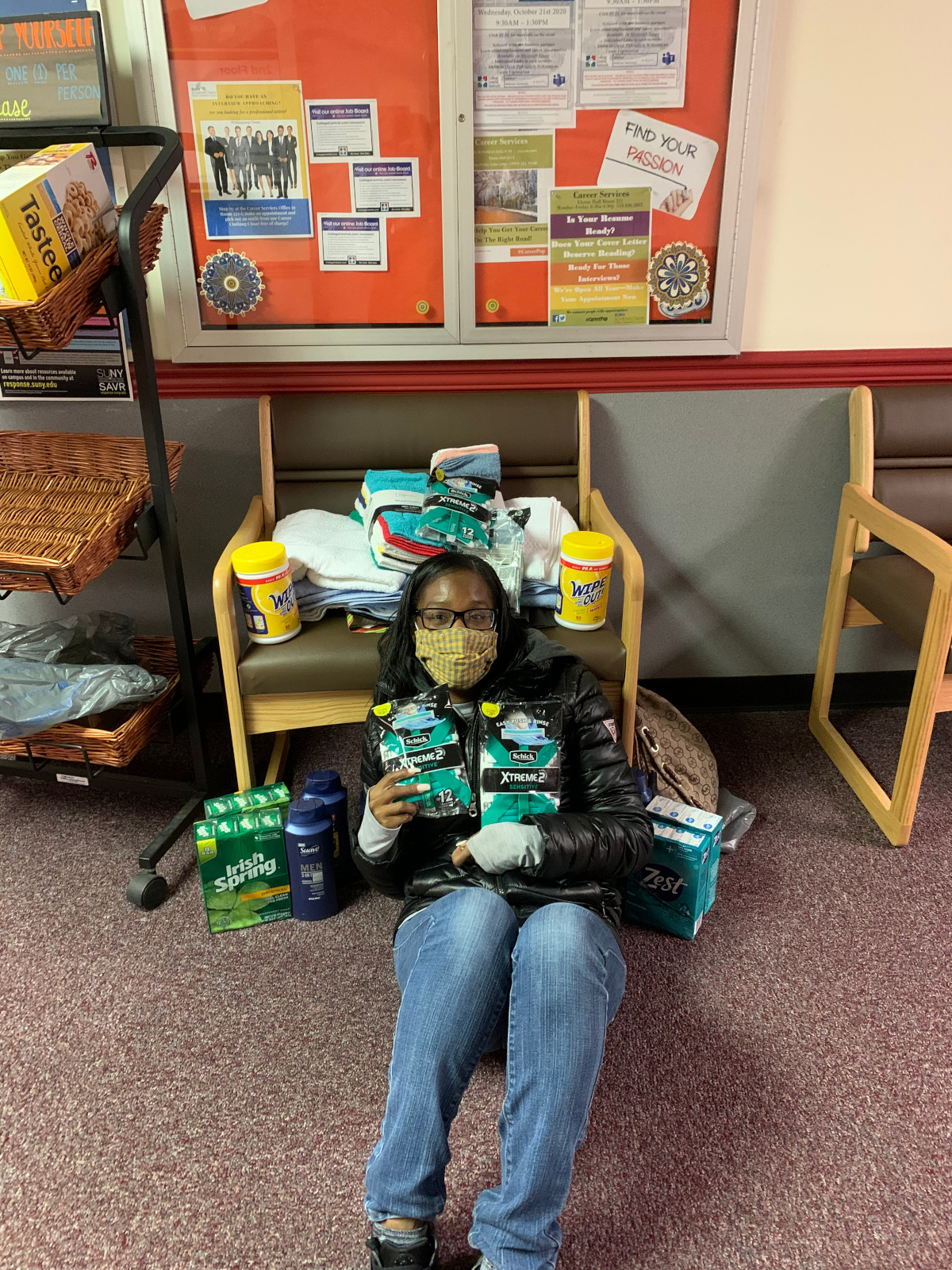 Shaniqua Pierce with some of the items her group collected for local non-proft agencies.