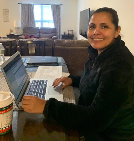 Brenda Beauregard on her laptop at home.