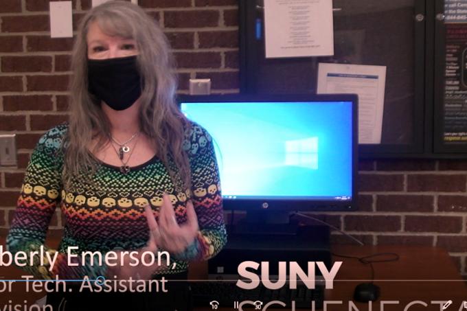 Kim Emerson speaking in video screenshot.